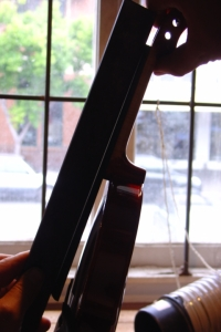 required hollowness of violin fingerboard