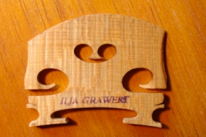 Brisbane Master Luthier shows one of his masterly crafted Violin bridges