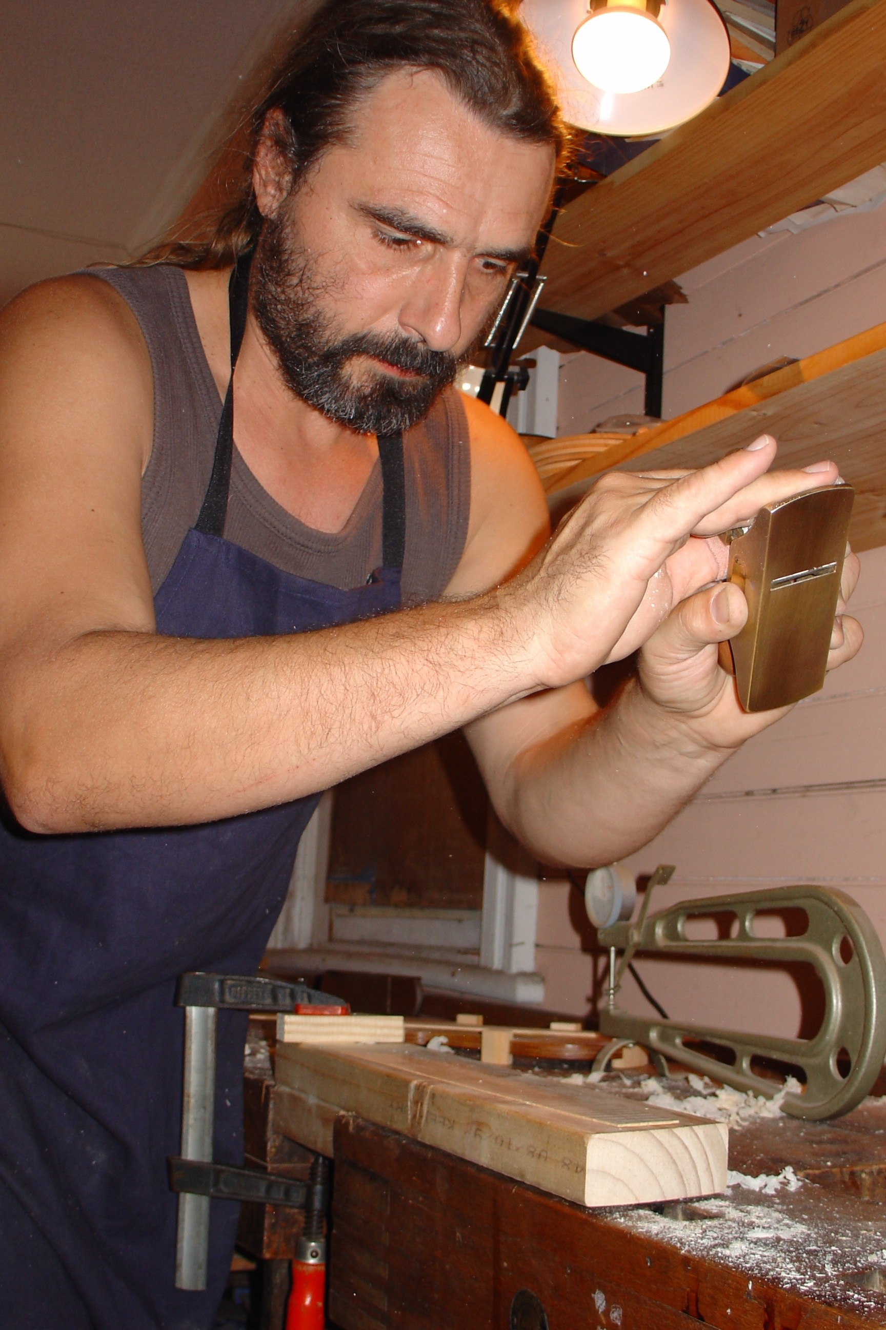 Master Violin maker at hos workbench